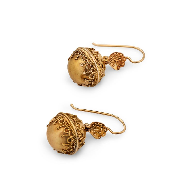 The Grand Period, 1860-1885, was a time of archaeological discoveries fostering a passionate revival of Egyptian, Classical Greek, and Etruscan styles. Victorian women swept their hair back and sported important looking ancient inspired jewelry such