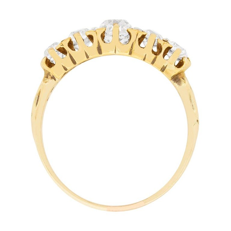 This beautiful handmade ring dates to the 1900s and is highly Victorian in style. It features five old cut diamonds graduating in size. The centre weighs 0.50 carat, adjacent either side weigh 0.25 carat and the ones on the end are 0.15 carat each.