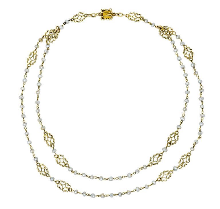 Necklace features two strands of pigtailed freshwater natural pearls measuring approximately 3.5 mm to 4.0 mm  Well-matched with cream body color and strong silvery overtones, good to very good luster  Accented throughout by scrolled filigree