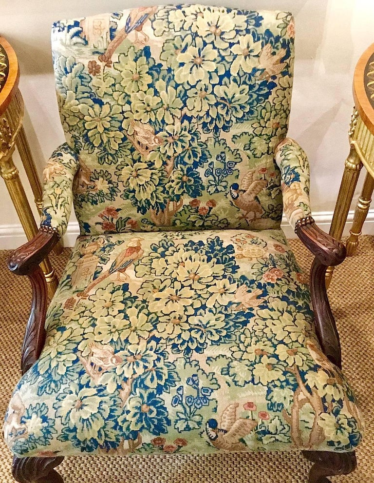 A Victorian George III style mahogany framed 'Gainsborough' armchair. This 'Gainsborough' style chair is from Ireland. It is upholstered in a Classic tapestry fabric with birds and foliage. Detailed carving on the arms and legs. It is very