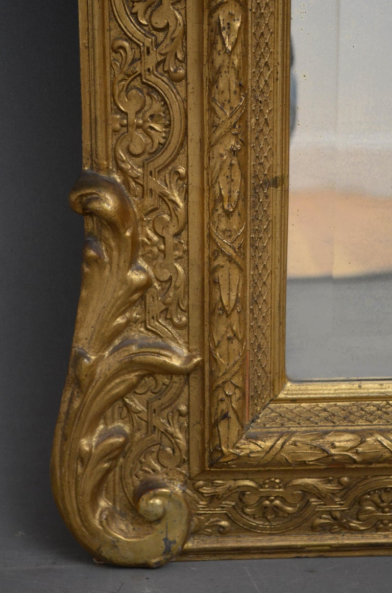 Sn4589 Victorian gilded wall mirror, having original bevelled edge glass with some foxing in finely carved frame. This antique mirror retains its original glass, gilt and backboard, circa 1870  Measures: H55? W26.5? d5?  H140cm W67cm