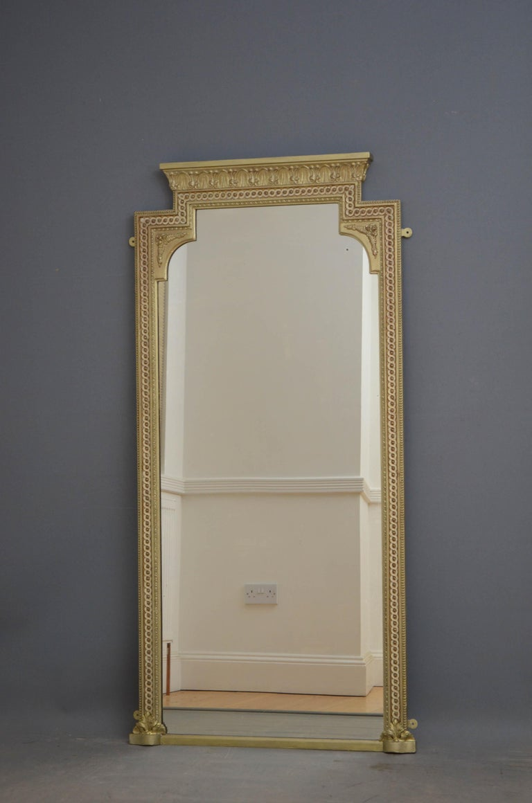 J00 tall and slim Victorian gilded wall mirror, having original mirror with some foxing in beaded and carved frame flanked by acanthus leaves to the base, fern leaf decoration to the top corners and foliage carved cornice. This antique mirror has