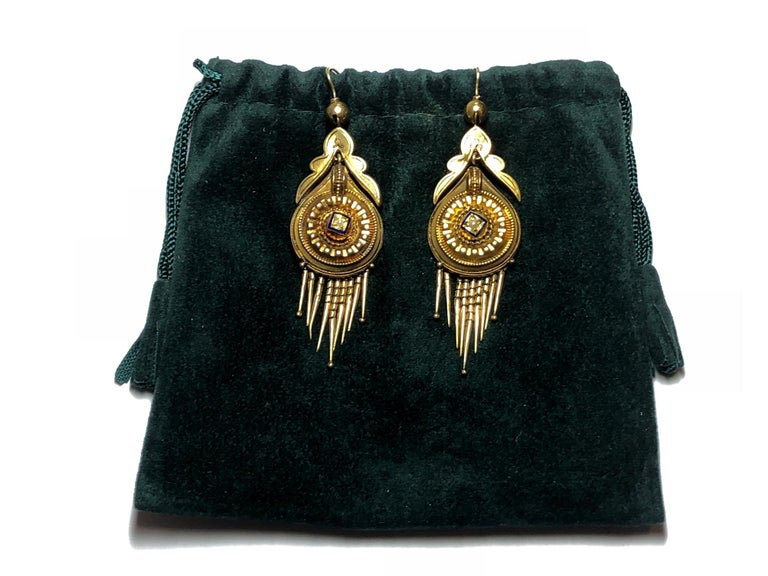 A pair of Victorian fringe earrings, centrally set with a seed pearl and blue enamel detail, with Etruscan style work, mounted in 15ct gold, circa 1875.