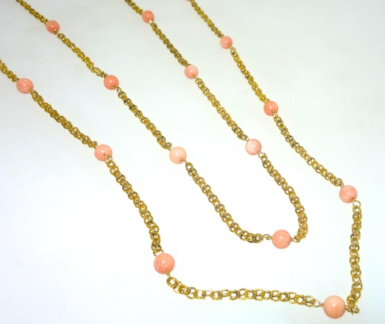 Late 19th Century long gold chain with 31 natural coral beads, the necklace is 61 inches long and can be worn a variety of lengths.  The piece weighs 34.22 grams and is in fine condition, circa 1890