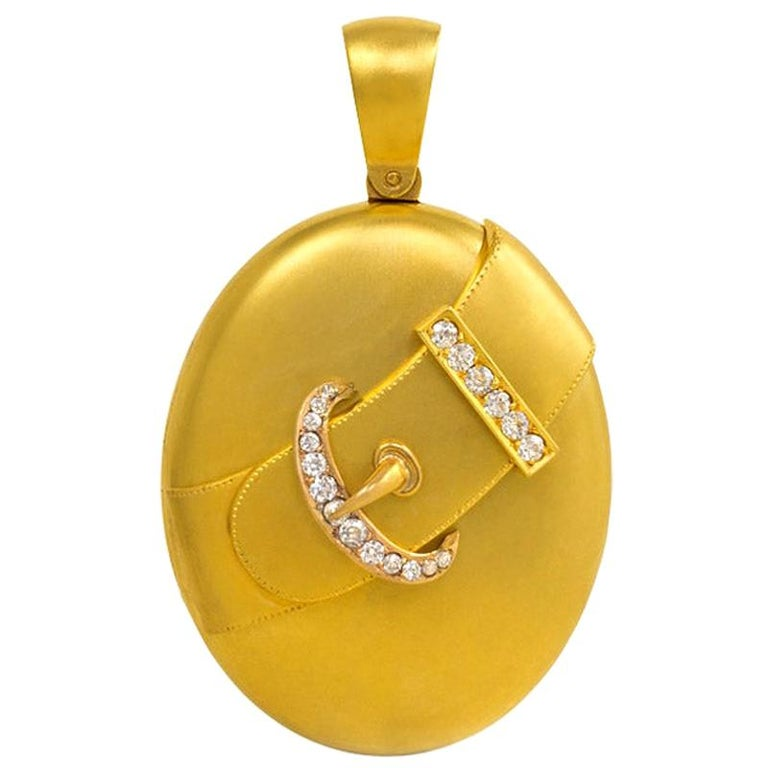 Victorian Gold Oval Two-Picture Locket with Diamond-Set Belt Strap Motif For Sale