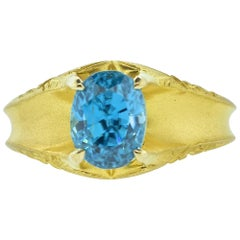 Victorian Gold Ring Centering a Natural Very Fine Blue Zircon, circa 1890