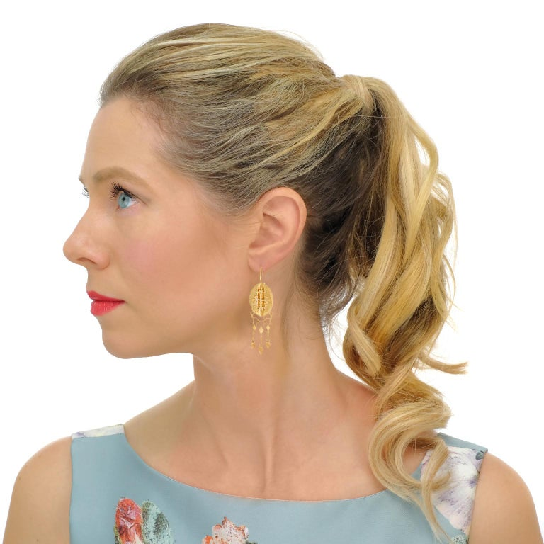 Circa 1870s, 14k.   These fabulous antique chandelier earrings are stylish, playful, and elegant. Their fine detail, contrasting textures, and articulated construction offer an exciting visual narrative. Completing the story, the gothic crosses with