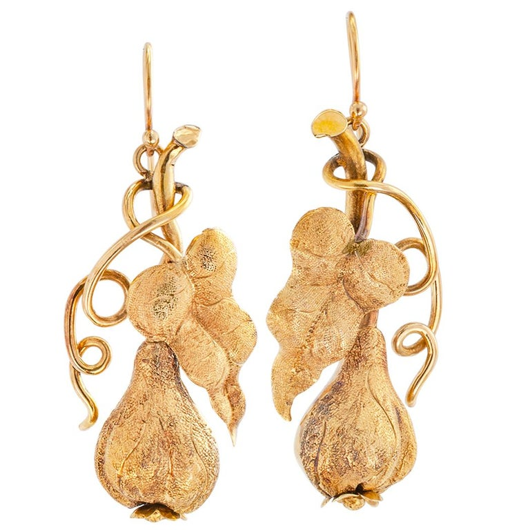 Victorian gold drop earrings circa 1890. Handcrafted, the left and right, three-dimensional, matching designs depict an exotic pear-shaped fruit on its vine, crafted in 12 – 14 karat yellow gold. Very pristine condition consistent with age and wear