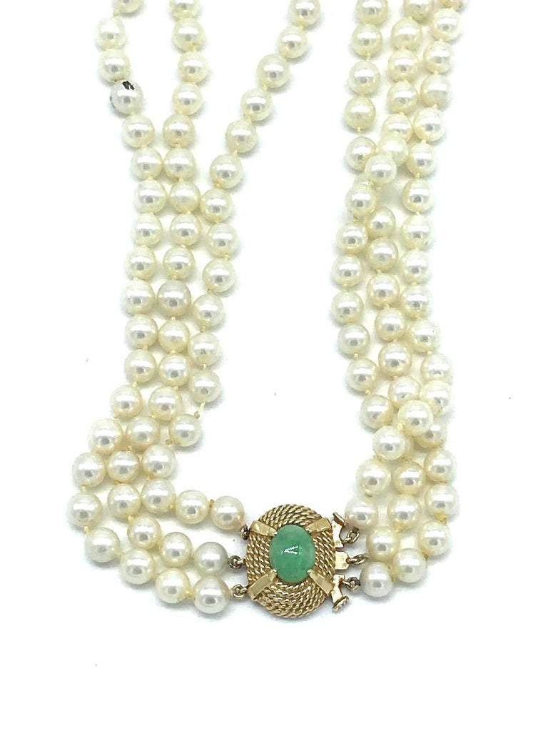 Vintage, Jade Clasp on 3-Strand 6 mm Pearl, Necklace  Graduated rows measuring 15-16-1/2 inches in length. Large 14 karat gold oval shaped, rope textured clasp measuring 19.05 x 15.5 mm wide. Jade is marbled colored green 10 x 9 mm, oval shaped