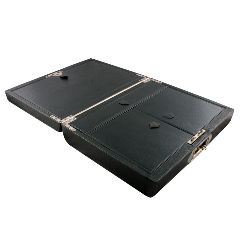 Victorian leather stationery box   A good quality late 19th century Victorian leather bound oak stationery box.  The black leather exterior has a tooled decoration, a plated lock plate to the front with a military style folding handle and a