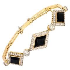 Victorian Lozenge Onyx and Diamond Bracelet in 18 Karat Gold, circa 1900
