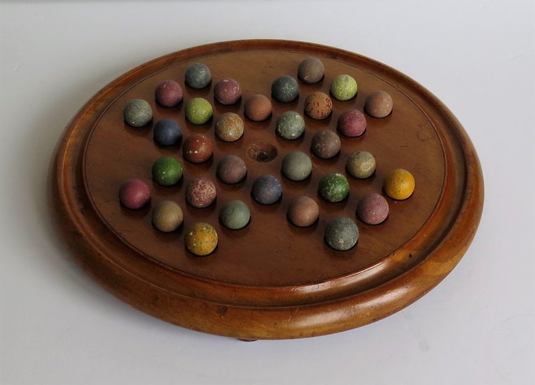 Hand-Crafted Victorian Marble Solitaire Game with Mahogany Board and 32 Handmade Marbles For Sale