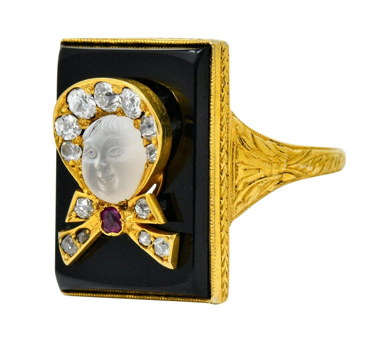 Victorian Moonstone Diamond Ruby Onyx Platinum Gold Carved Baby Face Ring For Sale 1
