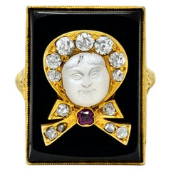 Victorian Moonstone Diamond Ruby Onyx Platinum Gold Carved Baby Face Ring