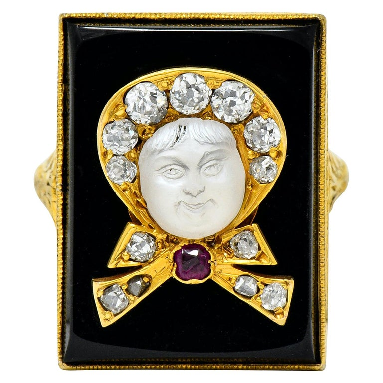 Victorian Moonstone Diamond Ruby Onyx Platinum Gold Carved Baby Face Ring For Sale