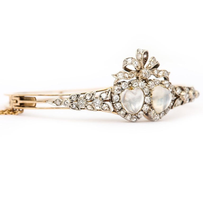 Old European Cut Victorian Moonstone Hearts and Bow Diamond Bangle 18 Karat Gold and Silver For Sale
