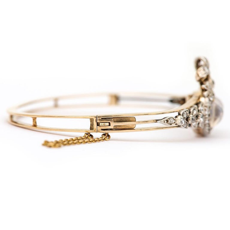 Victorian Moonstone Hearts and Bow Diamond Bangle 18 Karat Gold and Silver In Good Condition For Sale In Lancashire, Lancashire