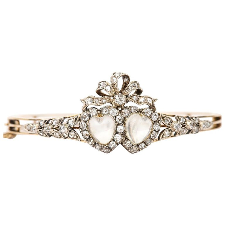 Victorian Moonstone Hearts and Bow Diamond Bangle 18 Karat Gold and Silver For Sale
