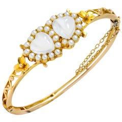 Victorian Moonstone Seed Pearl 14 Karat Gold Double Heart Bangle Bracelet