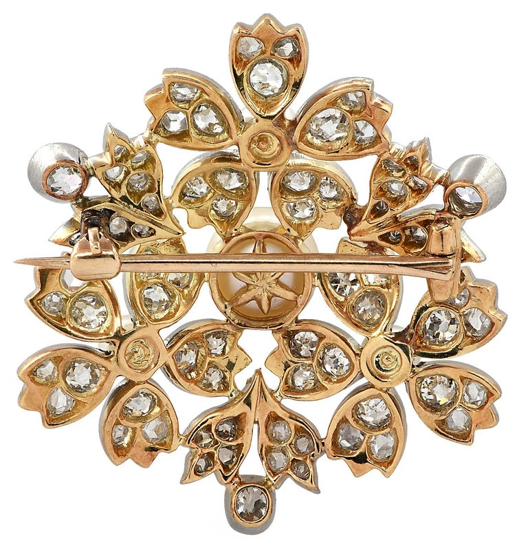 Delightful GIA certified Victorian Brooch pin crafted in platinum and 18 carat yellow gold showcasing four button shaped white natural pearls ranging from 3.90 mm to 7.61 mm in diameter and 60 Old European Cut, Old Mine Brilliant Cut and Rose Cut