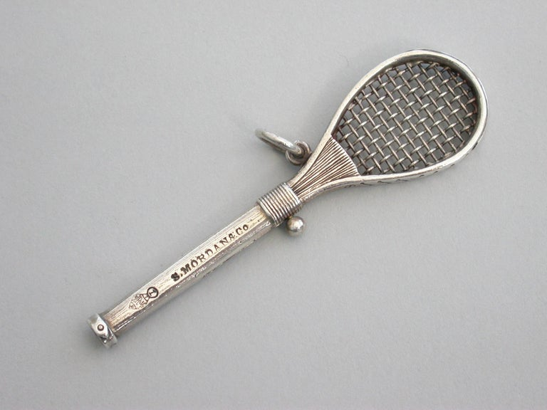 A rare Victorian novelty silver Propelling Pencil made in the form of a period tennis racket, the slide out pencil with ball finial. Stamped: S Mordan & Co and with a diamond registration mark for 7th September 1878.  By Sampson Mordan, circa