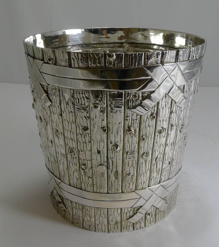 A magnificent and rare silver plated wine cooler of naturalistic form, striking an quite beautiful.