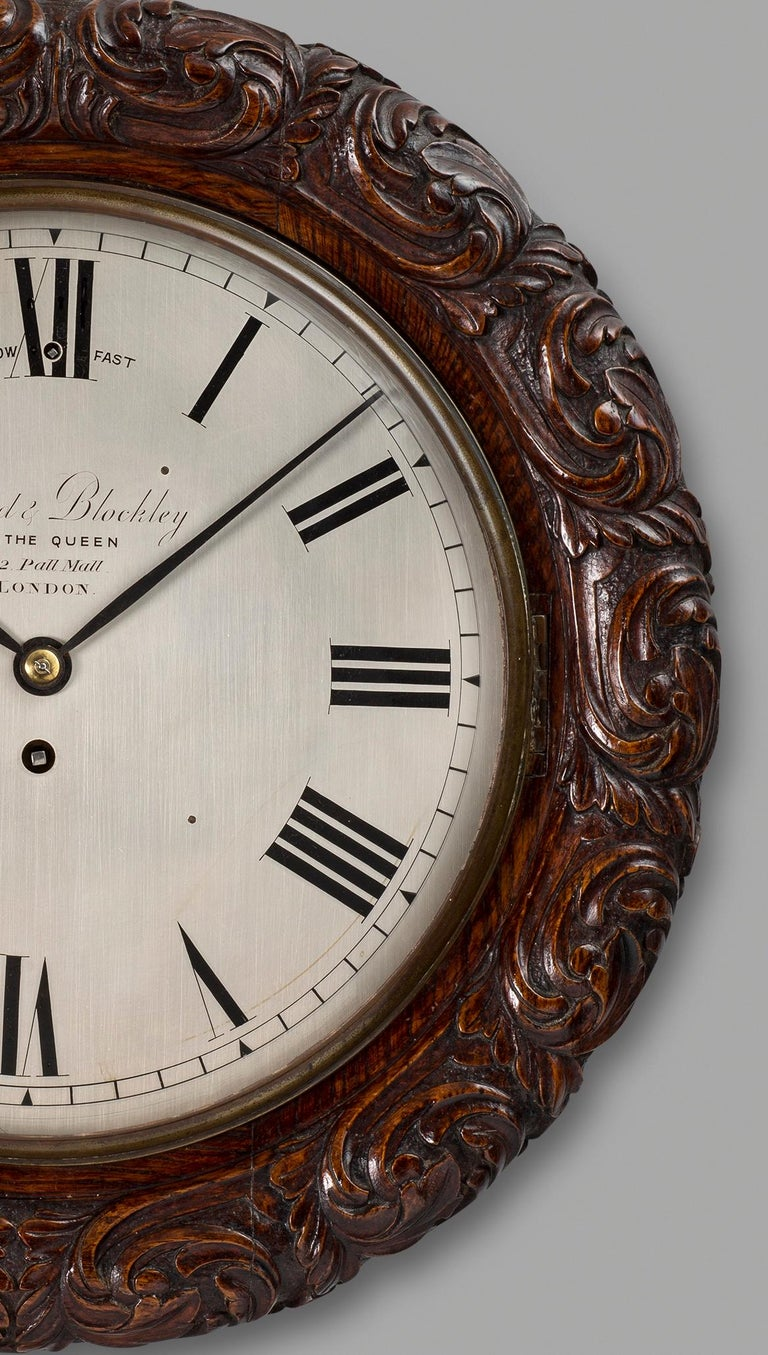 Victorian oak cased wall clock by Lund & Blockley, London