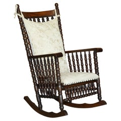 Victorian Oak Rocking Chair with Scottish Bobbin Turnings All over Cherub Fabric