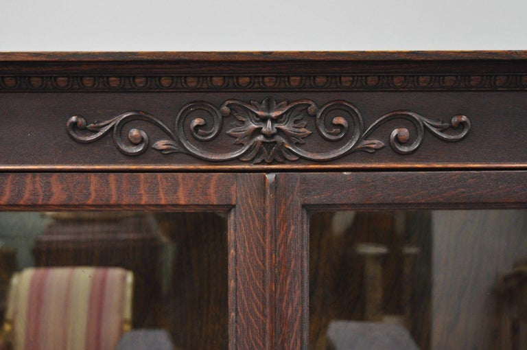 American Victorian Oak Wood Glass Two Door Bookcase Claw Feet Lion and Northwind Face For Sale