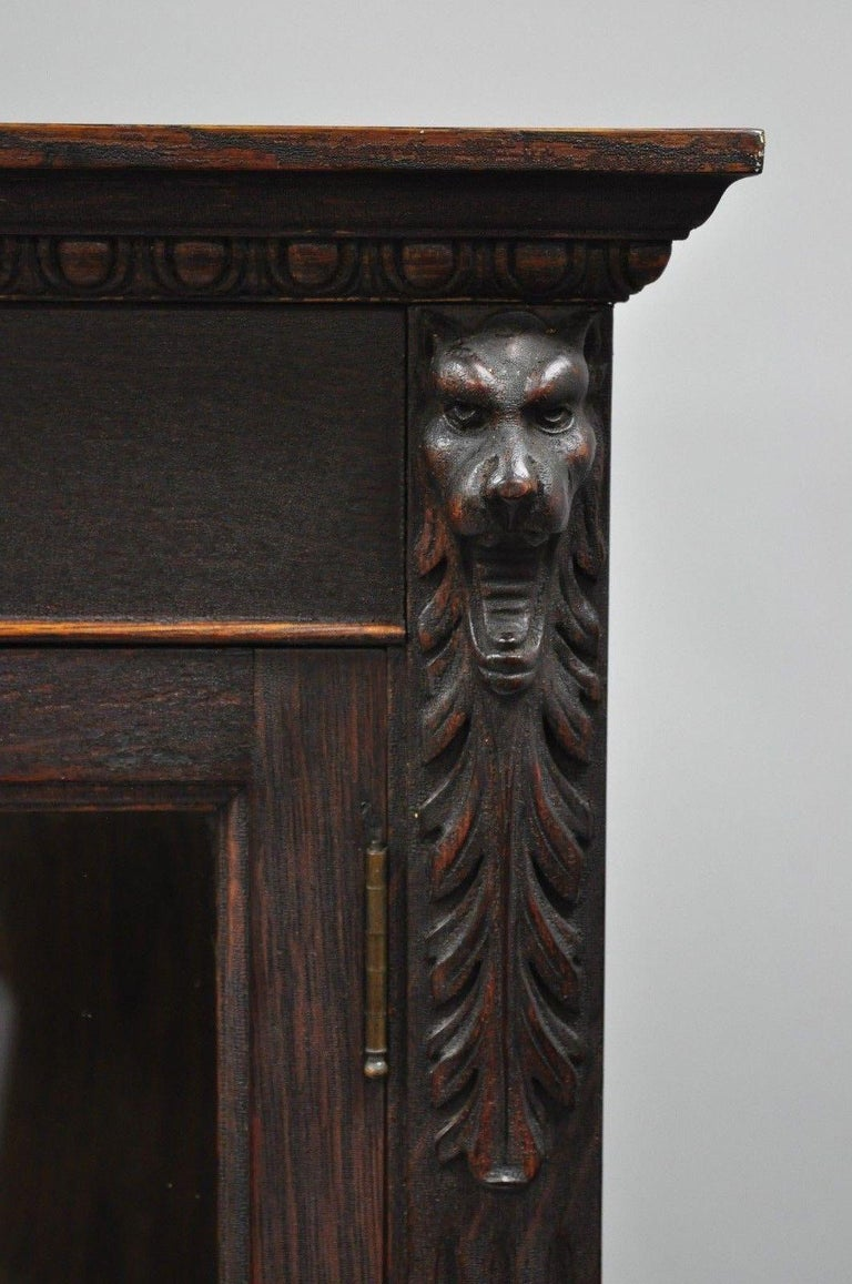 Victorian Oak Wood Glass Two Door Bookcase Claw Feet Lion and Northwind Face In Good Condition For Sale In Philadelphia, PA