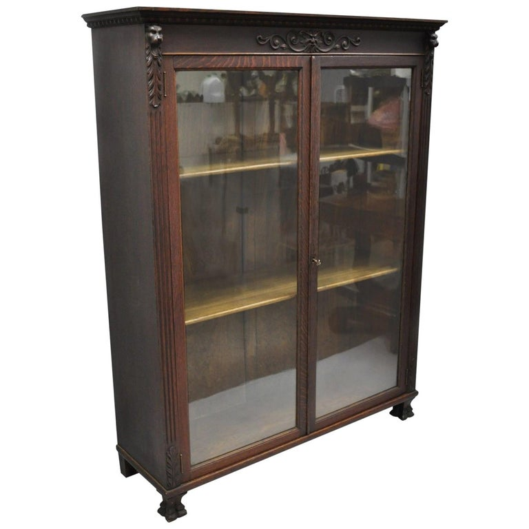 Victorian Oak Wood Glass Two Door Bookcase Claw Feet Lion and Northwind Face For Sale