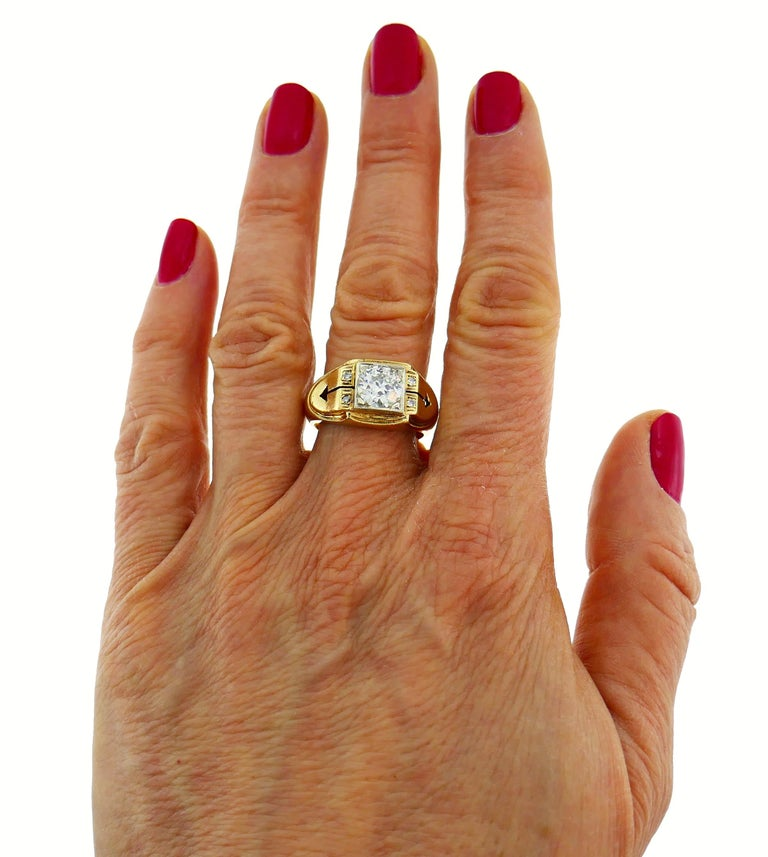Lovely Victorian unisex ring featuring an approximately 1.50-carat Old European cut diamond (J-K color, VS2 clarity) set in 14 karat gold and accented with four single cut diamonds. Size 9, can be re-sized. Weight 7.3 grams. Top part measures 1/2 x