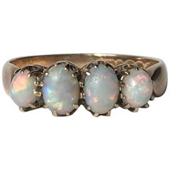 Victorian Opal and 9 Carat Gold Four-Stone Ring