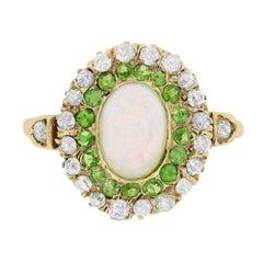 Victorian Opal, Green Garnet and Diamond Double Halo Ring, circa 1890s
