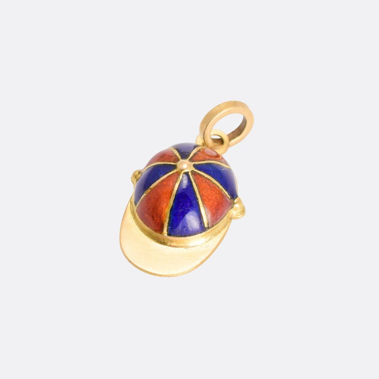 An especially good quality Victorian charm pendant modelled as a jockey's cap. It's crafted in 18k yellow gold and finished in orange and blue enamel - dating from the late 19th Century, circa 1890.  MEASUREMENTS  18.6 x 11.8mm (not including