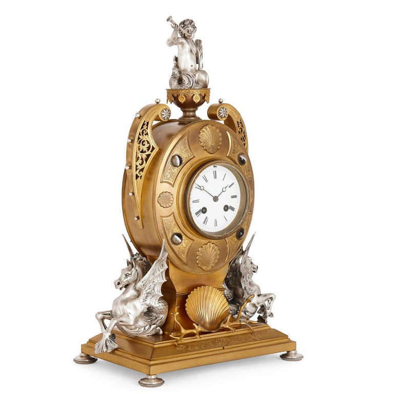 Victorian Ormolu and silvered bronze mantel clock English, 1871 Measures: Height 50cm, width 36cm, depth 19cm  The clock is a fine work in silvered and gilt bronze and features outstanding decorative detailing throughout. In particular, the