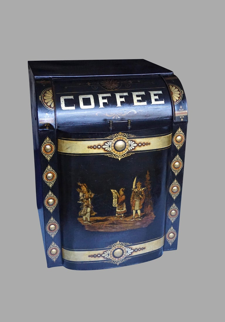 A wonderful Victorian country store counter top painted tole storage tin marked coffee, decorated with a central scene of 3 Asian figures framed by gilt bosses. This piece is large enough to be used as a side table. Restored.