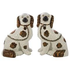 Victorian Pair of Staffordshire Pottery Copper Lustre Split Leg Dog Figurines