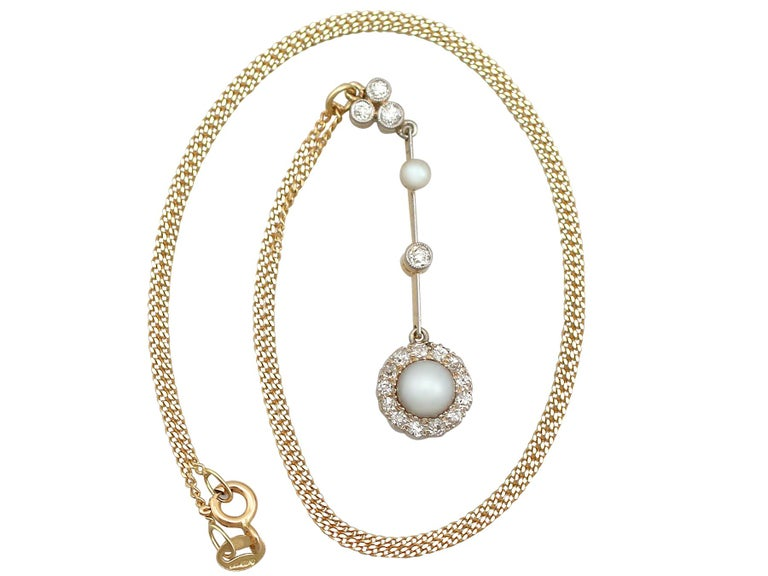 An exceptional, fine and impressive antique Victorian pearl and 0.42 carat diamond, 18 karat yellow gold and silver set pendant; part of our diverse antique jewelry and estate jewelry collections.  This exceptional, fine and impressive pearl and
