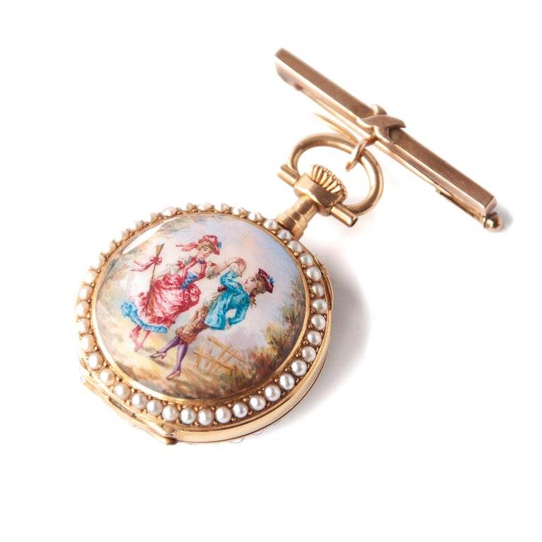 Metal: 14 karat yellow gold Stone: Pearls and enamel Dimensions: Diameter 3 cm Weight: 24 grams  Victorian 14 karat yellow gold ladies pocket watch with a painted enamel scenery of a dancing couple. The watch is surrounded with seventy-seven seed