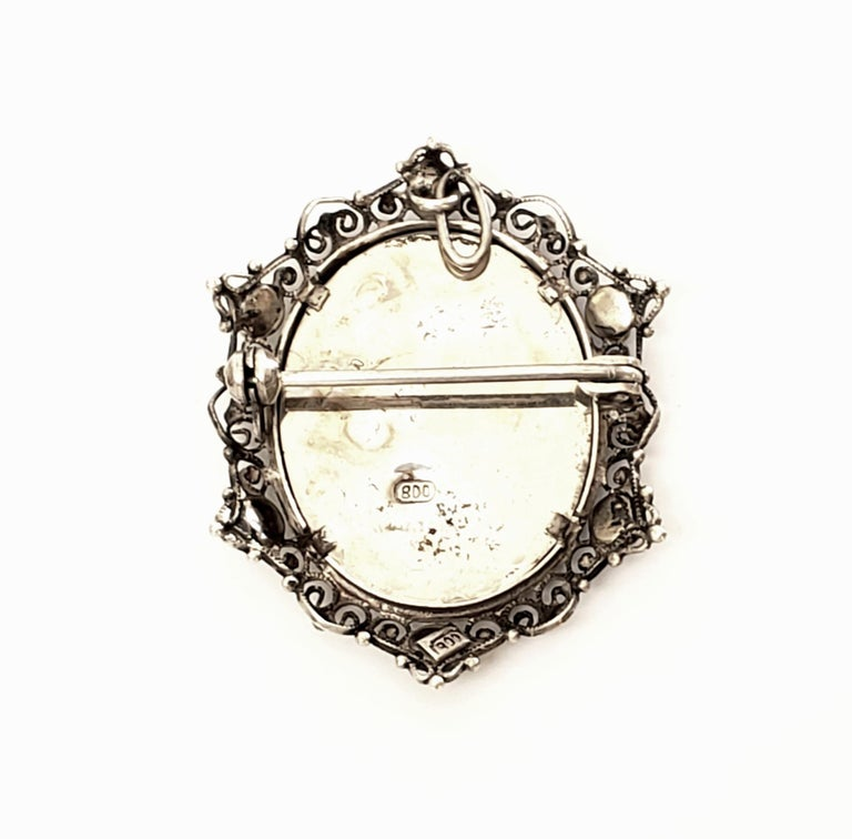 800 silver and blue bead portrait pin and pendant.  This beautiful piece can be worn as a pin or a pendant, features a hand painted lady's portrait in a 800 silver filigree frame with small blue beads.  Measures 1 1/2