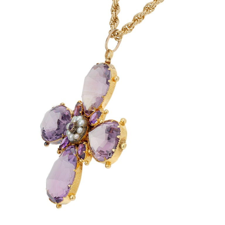 Amethyst and pearl Victorian 1890's cross shape pendant necklace. Natural amethyst and natural pearls in handmade 18k yellow gold with natural patina setting with 32 inch chain.  The back has a 7.5mm round center section with a crystal cover to