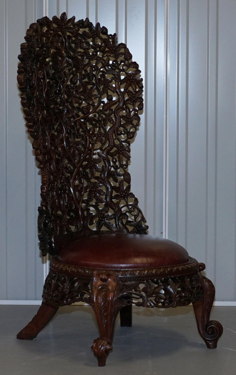 "We are delighted to offer for sale this is for an original pair of solid rare wood with new oxblood leather seats ""His & Hers"" pair of Anglo-Indian Burmese hand carved high back chairs