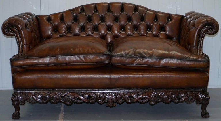 We are delighted to offer for sale this very rare fully restored George II style late Victorian hand carved with Lion hairy paw feet Chesterfield brown leather sofa  Please note the delivery fee listed is just a guide, it covers within the M25