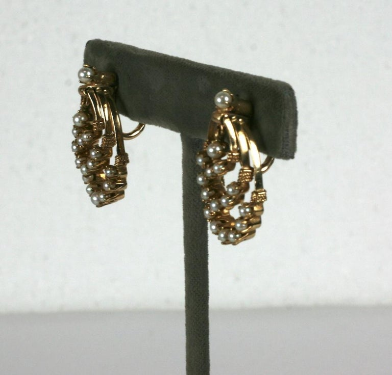 Victorian Revival Gold and Pearl Earrings from the 1960's. Designed as triple hoops set with miniature cultured pearls. All hoops swing independently of each other. They are fitted with clip back fittings.  A nice, easy alternative to period
