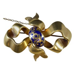Victorian Ribbon Brooch in Yellow Gold and Royal Blue Enamel Decoration