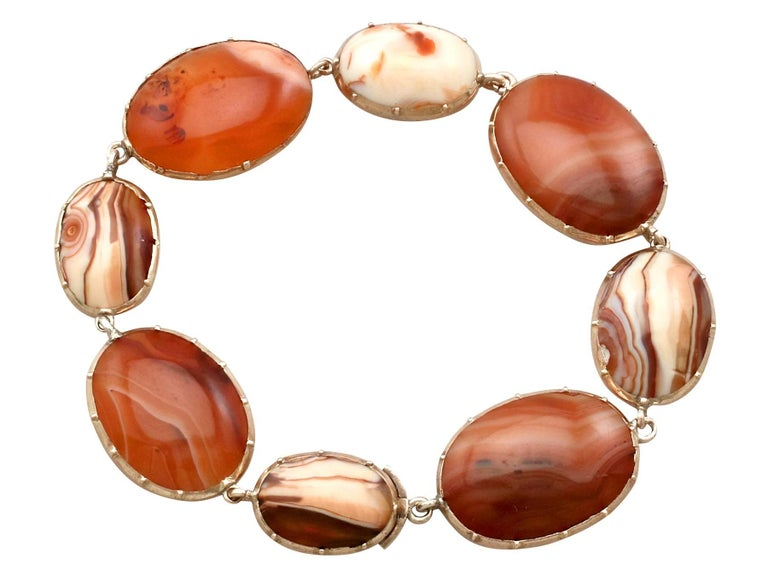 An impressive antique 1850's Victorian sardonyx and 9 carat yellow gold bracelet; part of our diverse antique jewellery and estate jewelry collections.  This fine and impressive antique agate bracelet has been crafted in 9ct yellow gold.  The