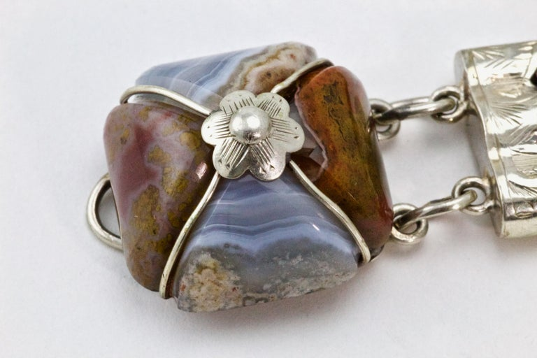 This fabulous, unusual, antique Victorian Scottish Silver bracelet is Circa 1860-1880, set with fabulous large fancy Agate links. Each polished agate link is a wonderful hue showing its natural grain from within. Scottish jewellery was made popular