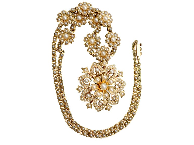 A stunning, fine and impressive antique Victorian seed pearl necklace/brooch in 15 karat yellow gold; part of our diverse antique estate jewelry collections.  This stunning, fine and impressive Victorian pearl necklace has been crafted in 15k yellow