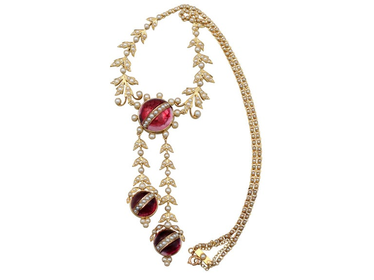 A stunning antique Victorian seed pearl and crystal, 15 karat yellow gold necklace; part of our diverse antique estate jewelry collections.  This stunning, fine and impressive antique necklace has been crafted in 15k yellow gold.  The feature